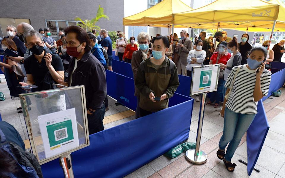 People waiting for their turn at the Covid-19 vaccination centre at Sun Yat Sen Memorial Park Sports Centre in Sai Ying Pun. Photo: May Tse