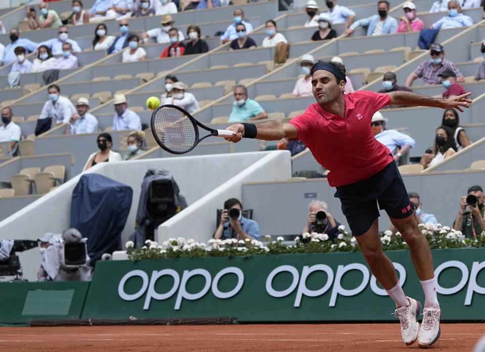 Switzerland's Roger Federer attempts to return serve to Croatia's Marin Cilic during their second round match on day 5, of the French Open tennis tournament at Roland Garros in Paris, France, Thursday, June 3, 2021. (AP Photo/Michel Euler)