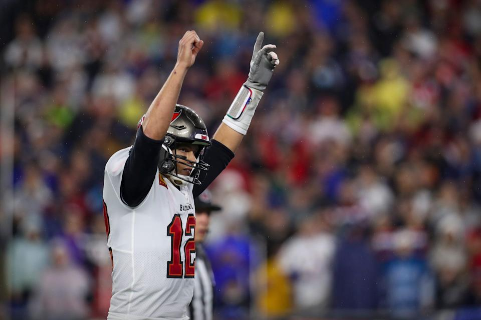 Tampa Bay Buccaneers quarterback Tom Brady (12) celebrates scoring against the New England Patriots during the second half at Gillette Stadium.