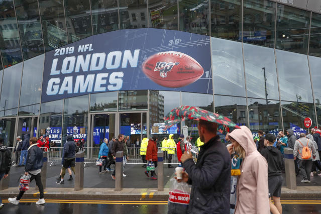NFL football fans arrive at Tottenham Hotspur Stadium to watch an NFL football game between the Tampa Bay Buccaneers and the Carolina Panthers, Sunday, Oct. 13, 2019, in London. (AP Photo/Alastair Grant)