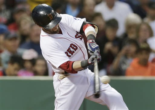 Boston Red Sox's Dustin Pedroia connects for a two-run home run off Toronto Blue Jays starting pitcher Chien-Ming Wang during the second inning of a baseball game at Fenway Park, Thursday, June 27, 2013, in Boston. (AP Photo/Charles Krupa)