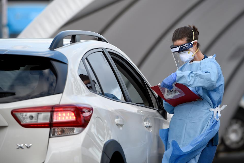 Medical professionals are seen performing COVID-19 tests on members of the public at the Bondi Beach drive-through coronavirus testing centre.