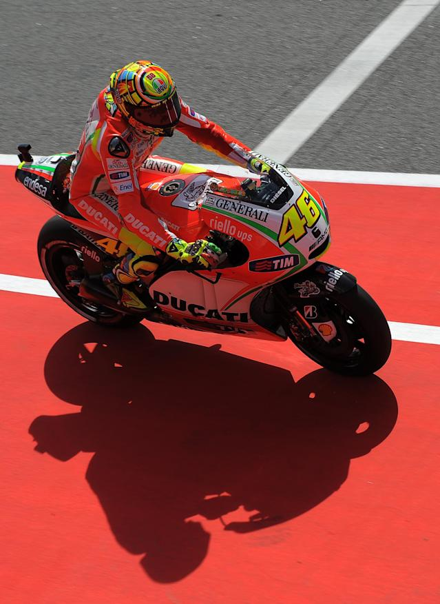 Ducati Team's Italian Valentino Rossi rides at the Catalunya racetrack in Montmelo, near Barcelona, on June 1, 2012, during the MotoGP first training session of the Catalunya Moto GP Grand Prix. AFP PHOTO/LLUIS GENE.LLUIS GENE/AFP/GettyImages