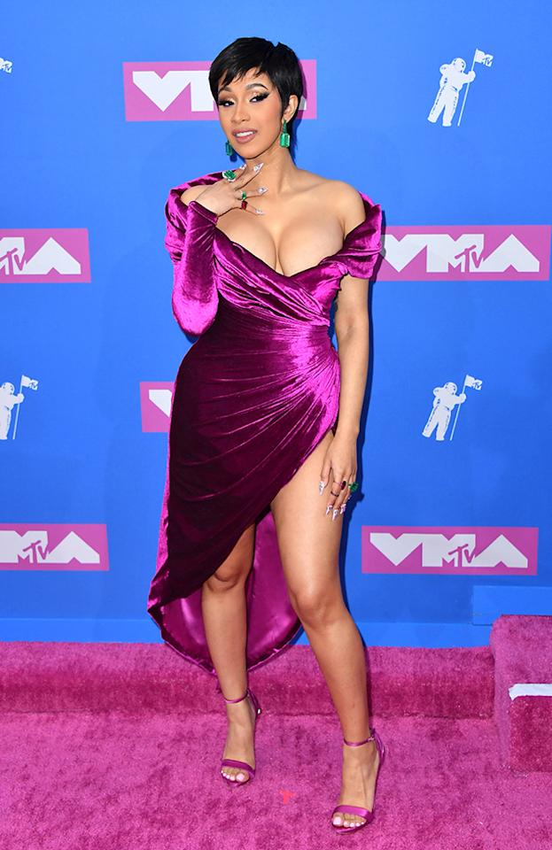 <p>Leave it to Cardi B to steal the show with her first official appearance since becoming a mom, thanks to her new pixie cut and velvet dress. (Photo: ANGELA WEISS/AFP/Getty Images) </p>