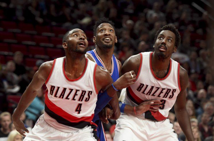 Robert Covington can't help but smile at all the attention he's getting. (AP)