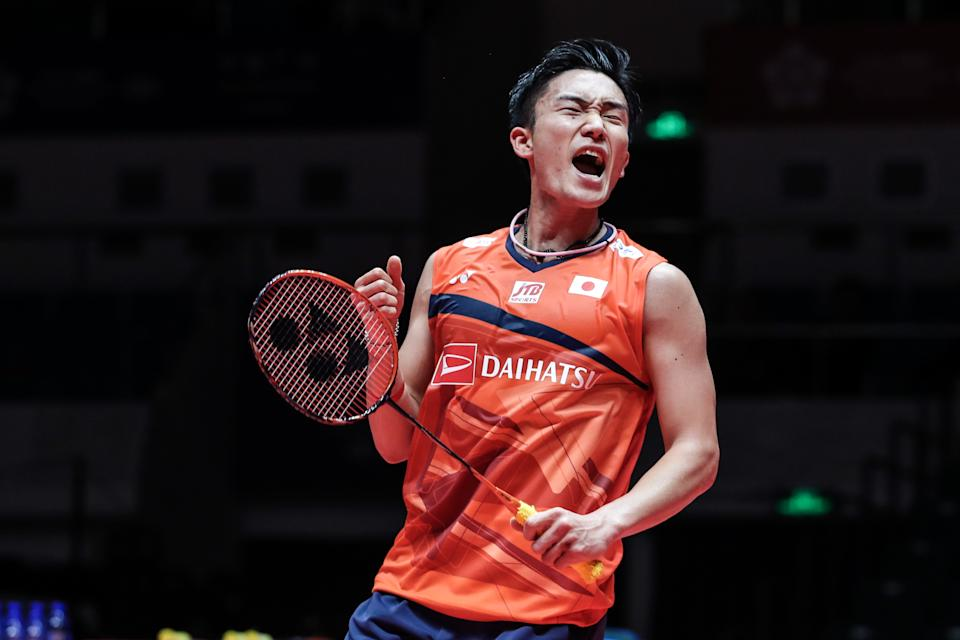 GUANGZHOU, CHINA - DECEMBER 12: Kento Momota of Japan celebrate the victory in the Men's Singles round robin match against Anders Antonsen of Denmark during day two of the HSBC BWF World Tour Finals at Tianhe Gymnasium on December 12, 2019 in Guangzhou, China. (Photo by Shi Tang/Getty Images)
