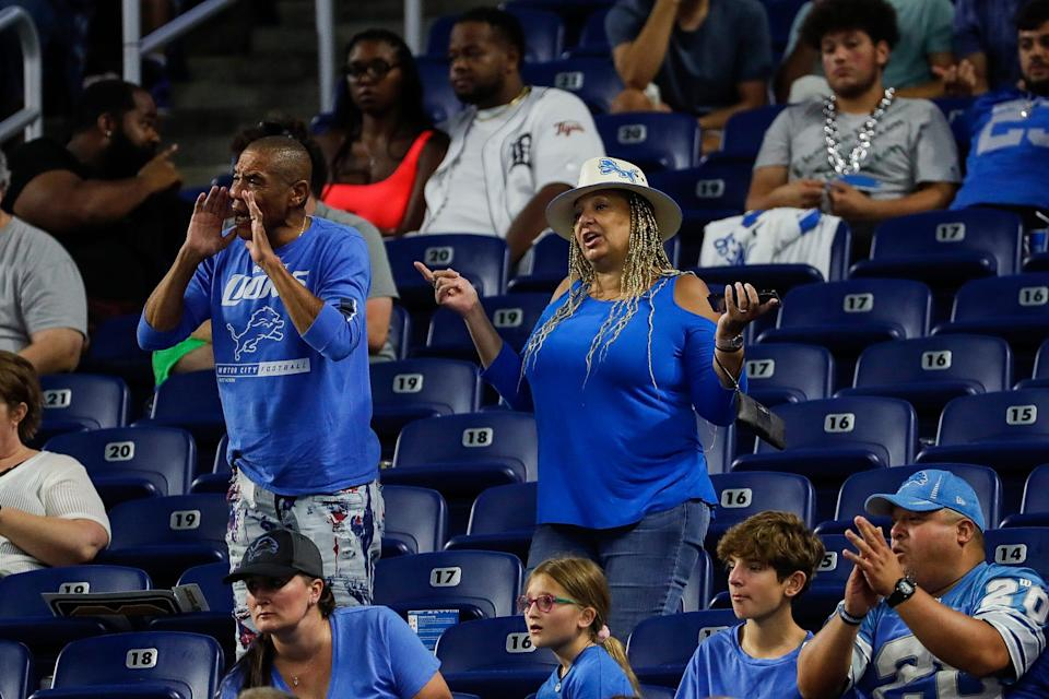 Detroit Lions fans cheer during the second half of a preseason game at Ford Field in Detroit on Friday, Aug. 27, 2021.