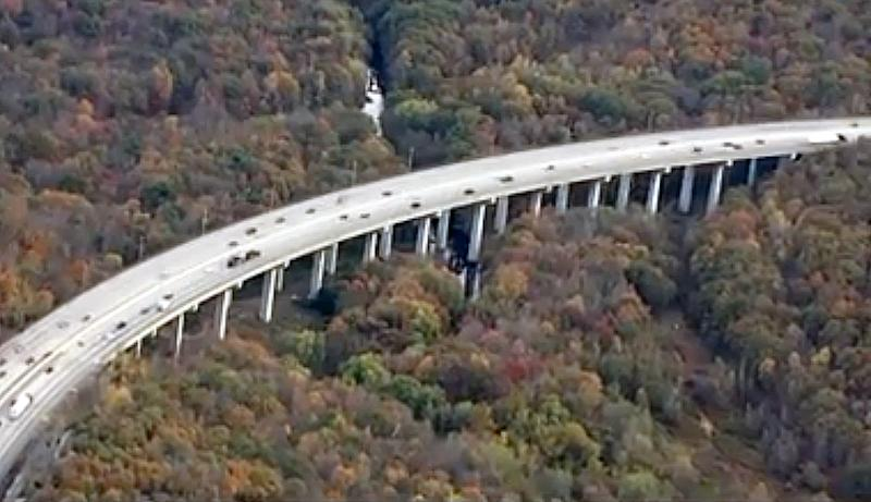 Man with sons in arms dies in leap from bridge