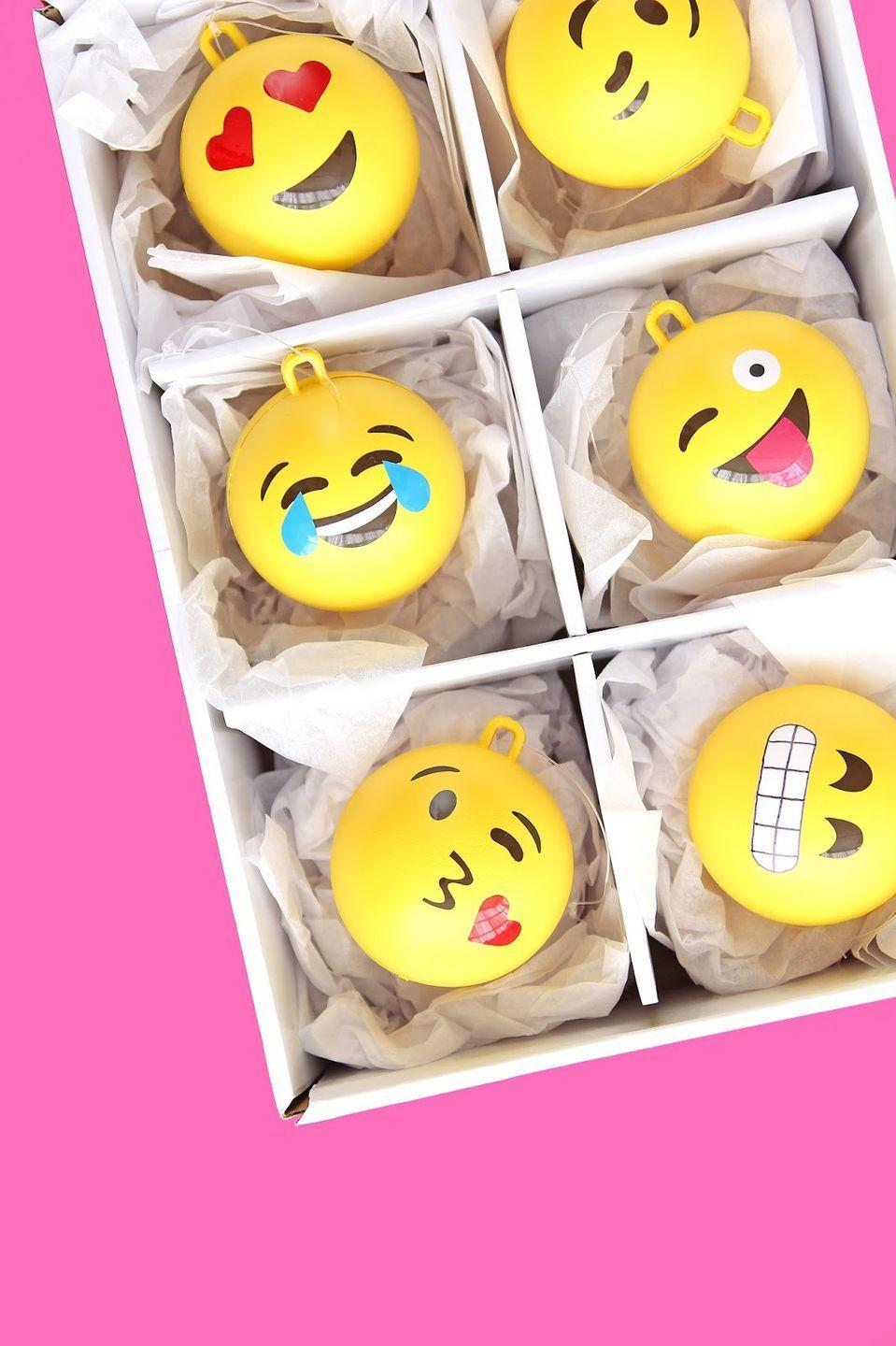 """<p>Infuse your tree with a hefty dose of personality by crafting bright yellow emoji-themed ornaments. </p><p><em>Get the tutorial at <a href=""""http://www.awwsam.com/2015/12/diy-emoji-ball-ornaments.html"""" rel=""""nofollow noopener"""" target=""""_blank"""" data-ylk=""""slk:Aww Sam"""" class=""""link rapid-noclick-resp"""">Aww Sam</a>.</em></p>"""
