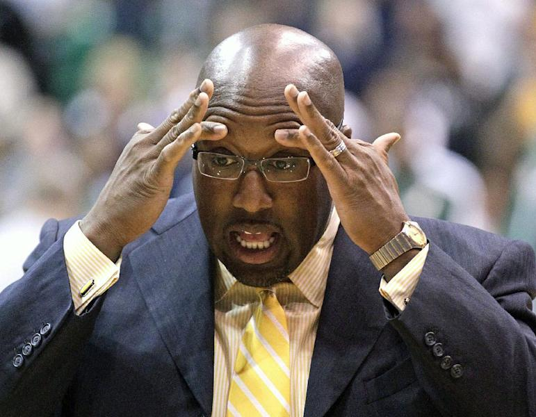FILE - In this Nov. 7, 2012 file photo Los Angeles Lakers head coach Mike Brown holds his head before the start of the first quarter during an NBA basketball game in Salt Lake City. A report from USA Today says the Lakers have fired Brown after a 1-4 start to his second season in charge of the team. The newspaper report Friday, Nov. 9, 2012 cited Brown's agent, Warren Legarie, as the source of the information. (AP Photo/Rick Bowmer, File)