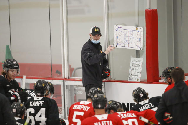 Chicago Blackhawks head coach Jeremy Collition talks to his players during hockey practice at Fifth Third Arena on Monday, July 13, 2020, in Chicago. (AP Photo/Kamil Krzaczynski)
