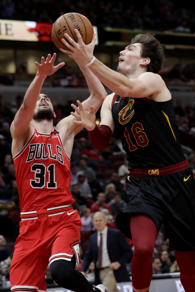 Cleveland Cavaliers forward Cedi Osman, right, shoots next to Chicago Bulls guard Tomas Satoransky during the second half of an NBA basketball game in Chicago, Saturday, Jan. 18, 2020. (AP Photo/Nam Y. Huh)