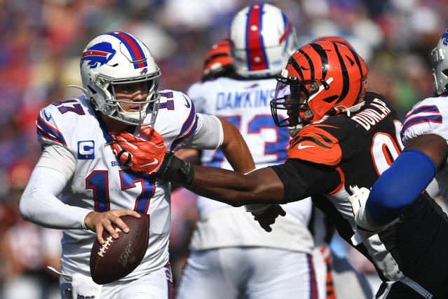 Cincinnati Bengals defensive end Carlos Dunlap (96) reaches for Buffalo Bills quarterback Josh Allen (17) during the second half of an NFL football game Sunday, Sept. 22, 2019, in Orchard Park, N.Y. (AP Photo/Adrian Kraus)