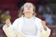 Distria Krasniqi of Kosovo reacts after competing against Funa Tonaki of Japan during their women's -48kg championship judo match at the 2020 Summer Olympics, Saturday, July 24, 2021, in Tokyo, Japan. (AP Photo/Vincent Thian)