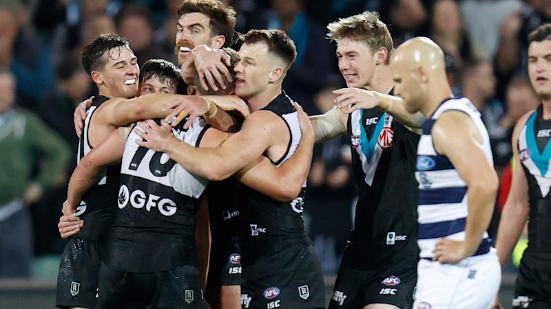 Port Adelaide players, pictured here celebrating a goal as Gary Ablett looks on.