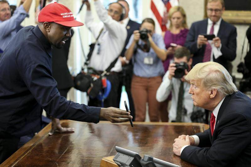Rapper Kanye West meets with President Donald Trump Thursday in the Oval Office at the White House. (The Independent)