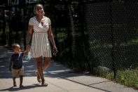 FILE PHOTO: Chantel Springer walks with her son Jasiah in the Brooklyn borough of New York