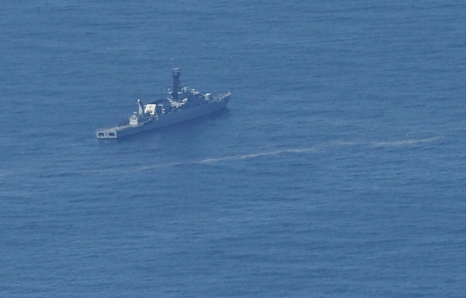 In this aerial photo taken from a maritime patrol aircraft of 800 Air Squadron of the 2nd Air Wing of Naval Aviation Center (PUSPENERBAL), an Indonesian Navy ship sails during a search for the submarine KRI Nanggala that went missing while participating in a training exercise on Wednesday in the waters off Bali Island, Indonesia, Thursday, April 22, 2021. Indonesia's navy ships on Thursday were intensely searching for the submarine that likely fell too deep to retrieve, making survival chances for all the crew on board slim. Authorities said oxygen in the submarine would run out by early Saturday. (AP Photo/Eric Ireng)