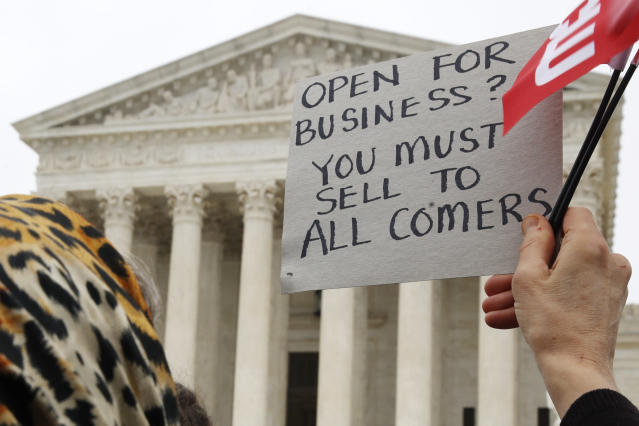 <p>A woman holds up a sign as people gather outside of the Supreme Court which is hearing the 'Masterpiece Cakeshop v. Colorado Civil Rights Commission' today, Tuesday, Dec. 5, 2017, in Washington. (Photo: Jacquelyn Martin/AP) </p>