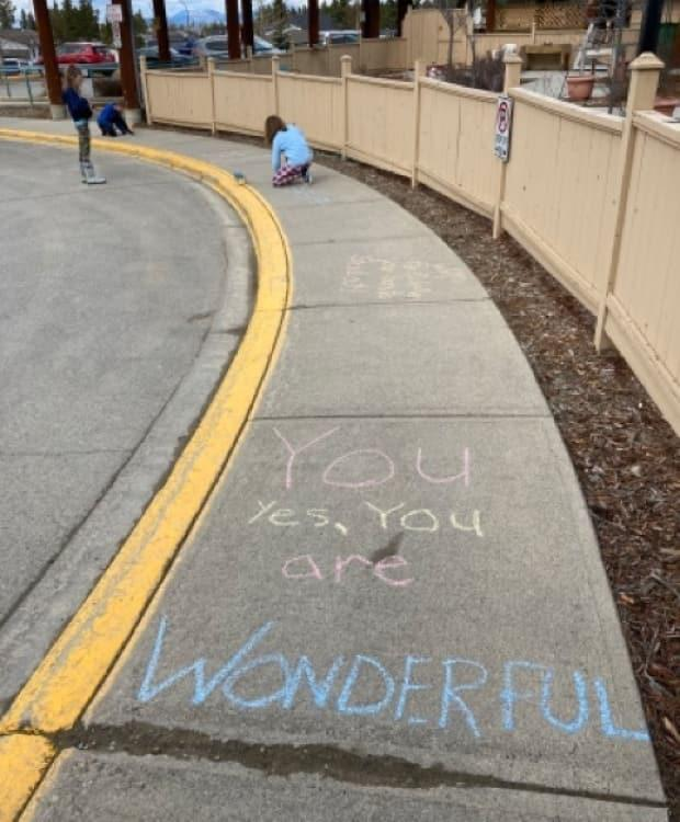 Members of the Kindness Club created positive messages for the elders at Copper Ridge Place, through sidewalk art.