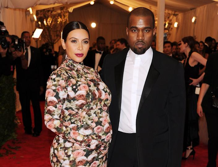 """Kim Kardashian and Kanye West attend The Metropolitan Museum of Art's Costume Institute benefit celebrating """"PUNK: Chaos to Couture"""" on Monday, May 6, 2013, in New York. (Photo by Evan Agostini/Invision/AP)"""