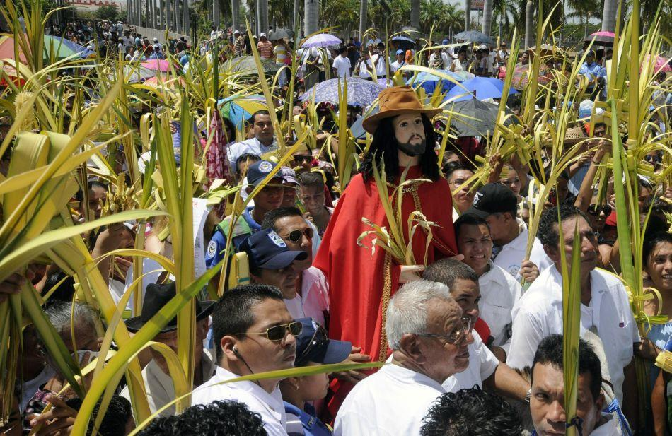 Catholics participate in the onset of the Easter procession of the Palm Sunday at the Metropolitan Cathedral in Managua, Nicaragua.