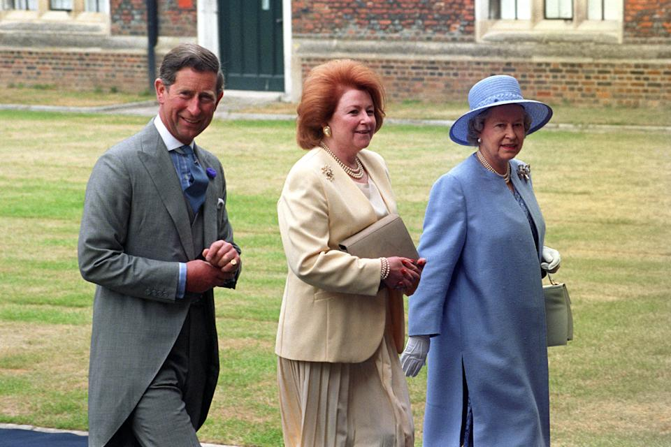 File photo dated 01/07/95 of the Queen's cousin Lady Elizabeth Shakerley (centre) who has died aged 79, seen walking with the Queen and the Prince of Wales at a wedding reception in Hampton Court Palace for the exiled Crown Prince Pavlos of Greece and Marie-Chantal Miller. More widely known in her professional capacity as Lady Elizabeth Anson, she was a close friend of the Queen and responsible for arranging many of her private parties.. Issue date: Sunday November 1, 2020. See PA story DEATH Shakerley. Photo credit should read: Sean Dempsey/PA Wire