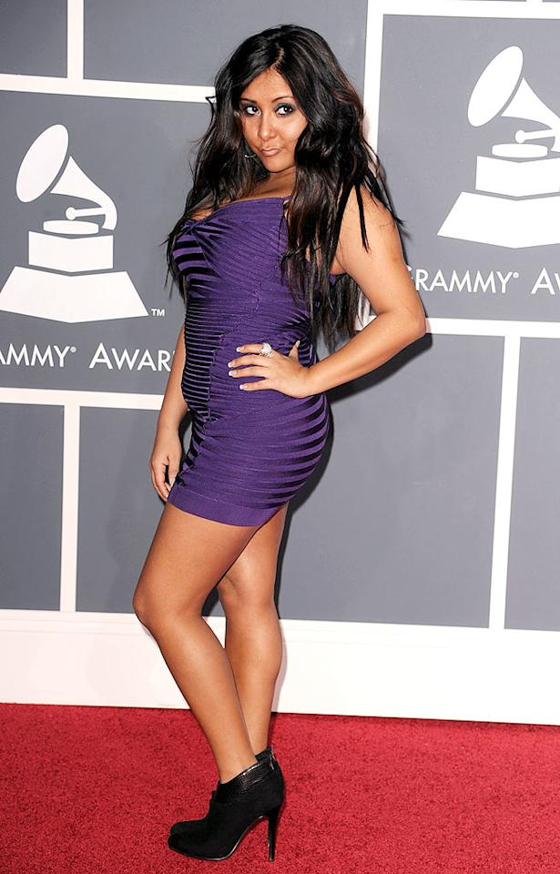 "Nicole ""Snooki"" Polizzi  Grade: D   The hot tubbin', tanning bed lovin', self-described guidette could barely breathe in her tacky purple mini and hoof-like heels. Steve Granitz/<a href=""http://www.wireimage.com"" target=""new"">WireImage.com</a> - January 31, 2010"