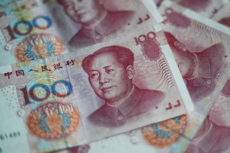 The yuan has fallen around eight percent since the end of March (AFP Photo/FRED DUFOUR)