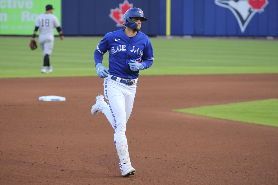 Toronto Blue Jays Cavan Biggio rounds the bases after hitting a home run off New York Yankees pitcher Gerrit Cole during the fifth inning of a baseball game Wednesday, June 16, 2021, in Buffalo, N.Y. (AP Photo/Jeffrey T. Barnes)