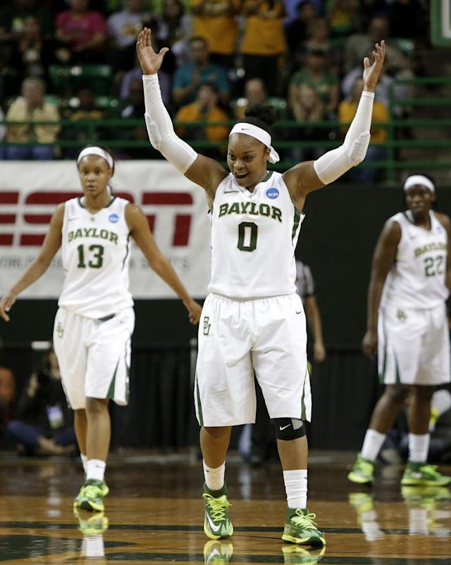Baylor's Odyssey Sims (0) celebrates sinking a 3-point basket as Nina Davis (13) and Sune Agbuke (22) watche late in the second half of a second-round game against California in the NCAA women's college basketball tournament, Monday, March 24, 2014, in Waco, Texas. Baylor won 75-56. (AP Photo/Tony Gutierrez)