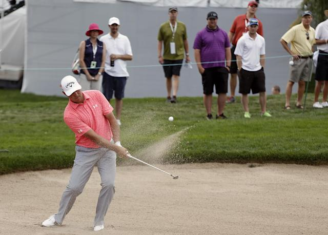 Gary Woodland hits a sand shot onto the eighth hole green during the first round of the BMW Championship golf tournament at Cherry Hills Country Club in Cherry Hills Village, Colo., Thursday, Sept. 4, 2014. (AP Photo/Brennan Linsley)