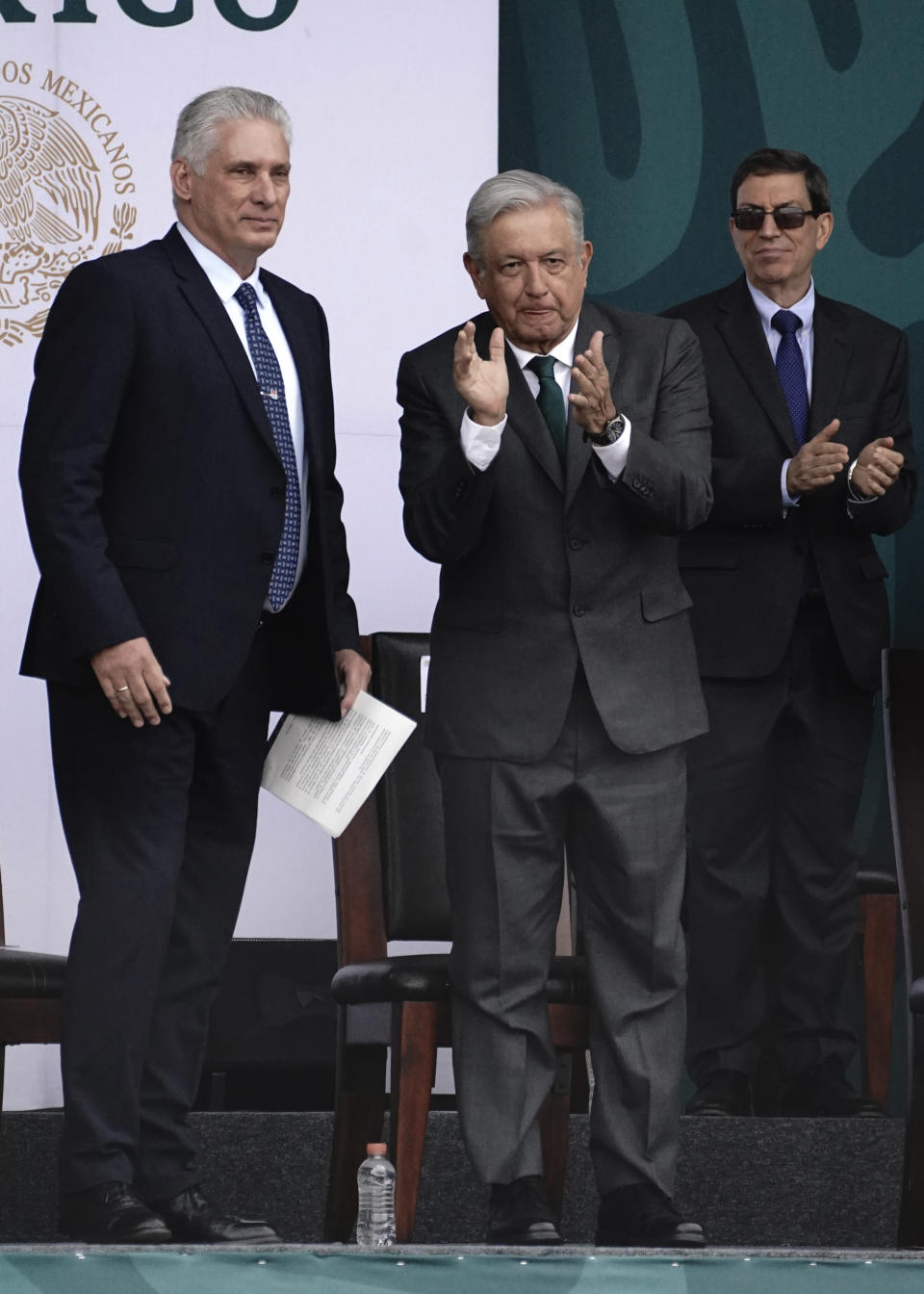 Cuba's President Miguel Diaz-Canel, left, accompanies Mexico's President Andres Manuel Lopez Obrador, during Independence Day celebrations, in the Zocalo in Mexico City, Thursday, Sept. 16, 2021. (AP Photo/Marco Ugarte)