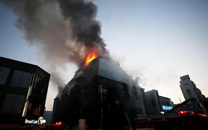 Smoke rises from a burning building in Jecheon, South Korea, December 21 - REUTERS