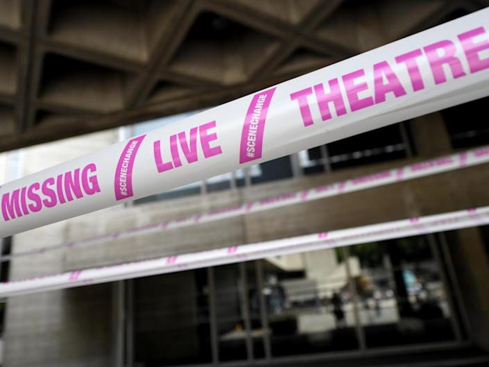 The National Theatre wrapped in pink tape as part of a campaign by #scenechange to help bring shows back into production: Rex Features