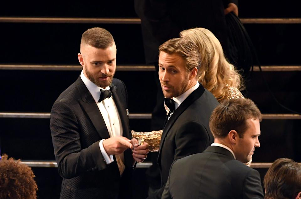 Justin Timberlake (left) catches up with former roomie Ryan Gosling at the 89th Annual Academy Awards in 2017