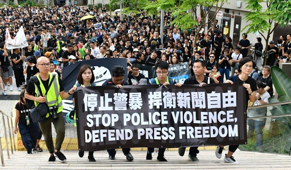 The Hong Kong Journalists Association hosts a silent march against police violence during protests in July last year. Photo: Warton Li