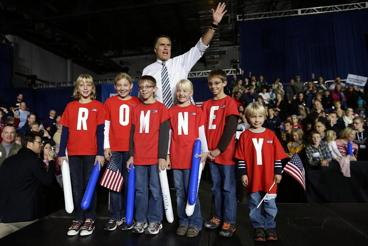 "Republican presidential candidate and former Massachusetts Gov. Mitt Romney poses with children wearing shirts which spell out ""Romney"" as he campaigns at the Iowa Events Center, in Des Moines, Sunday, Nov. 4, 2012. (AP Photo/Charles Dharapak)"