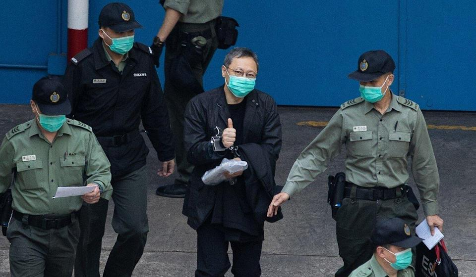 Hong Kong legal scholar Benny Tai flashes a thumbs up as he walks to a prison van on his way to court on Wednesday. Photo: EPA-EFE