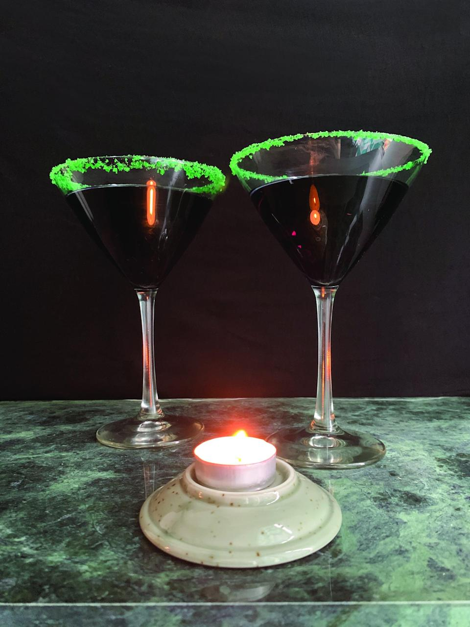 <p><strong>Serves:</strong> 1   <strong>Prep Time:</strong> 10 minutes</p> <p><strong>Ingredients:</strong><br> 1/8 cup sugar<br> food coloring<br> lime wedge<br> 2 ounces Captain Morgan Black Rum<br> 1/2 ounce dry vermouth<br> blackberry, for garnish<br> 1/4 ounce Bacardi 151</p> <p><strong>Directions:</strong></p> <ol> <li>Chill a cocktail glass.</li> <li>Pour the sugar into a small resealable storage bag.</li> <li>Add a few drops of the food coloring to turn the sugar the desired color. Shake the bag well to distribute the coloring throughout the sugar.</li> <li>Dump the bag contents onto a plate.</li> <li>Use a lime wedge to rim the cocktail glass.</li> <li>Dip the rim of the glass in the colored sugar so it is evenly coated with the sugar.</li> <li>Fill a cocktail shaker with ice. Add the black rum and vermouth and shake well.</li> <li>Strain the cocktail into the rimmed glass.</li> <li>Garnish with a blackberry.</li> <li>Optional: Drizzle the Bacardi 151 onto the top of the cocktail and light on fire. Let it burn out before you drink!</li> </ol>