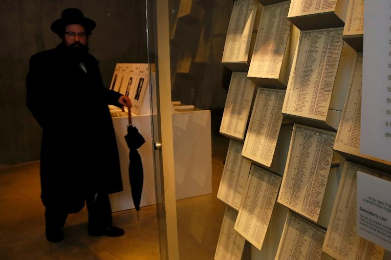An Ultra-Orthodox Jewish man looks at facsimiles of Oskar Schindler's lists displayed for the public at the Yad Vashem Holocaust memorial in Jerusalem, where the original documents are being stored in the museum's archives (AFP Photo/Gali Tibbon)