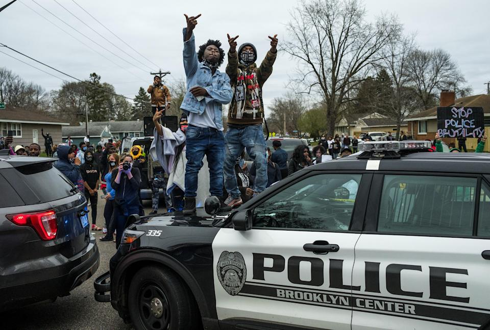 <p>People stand on a police cruiser as protesters take to the streets after Brooklyn Center police shot and killed Daunte Wright during a traffic stop on April 11, 2021 in Brooklyn Center, Minnesota.</p> (Photo by Stephen Maturen/Getty Images)