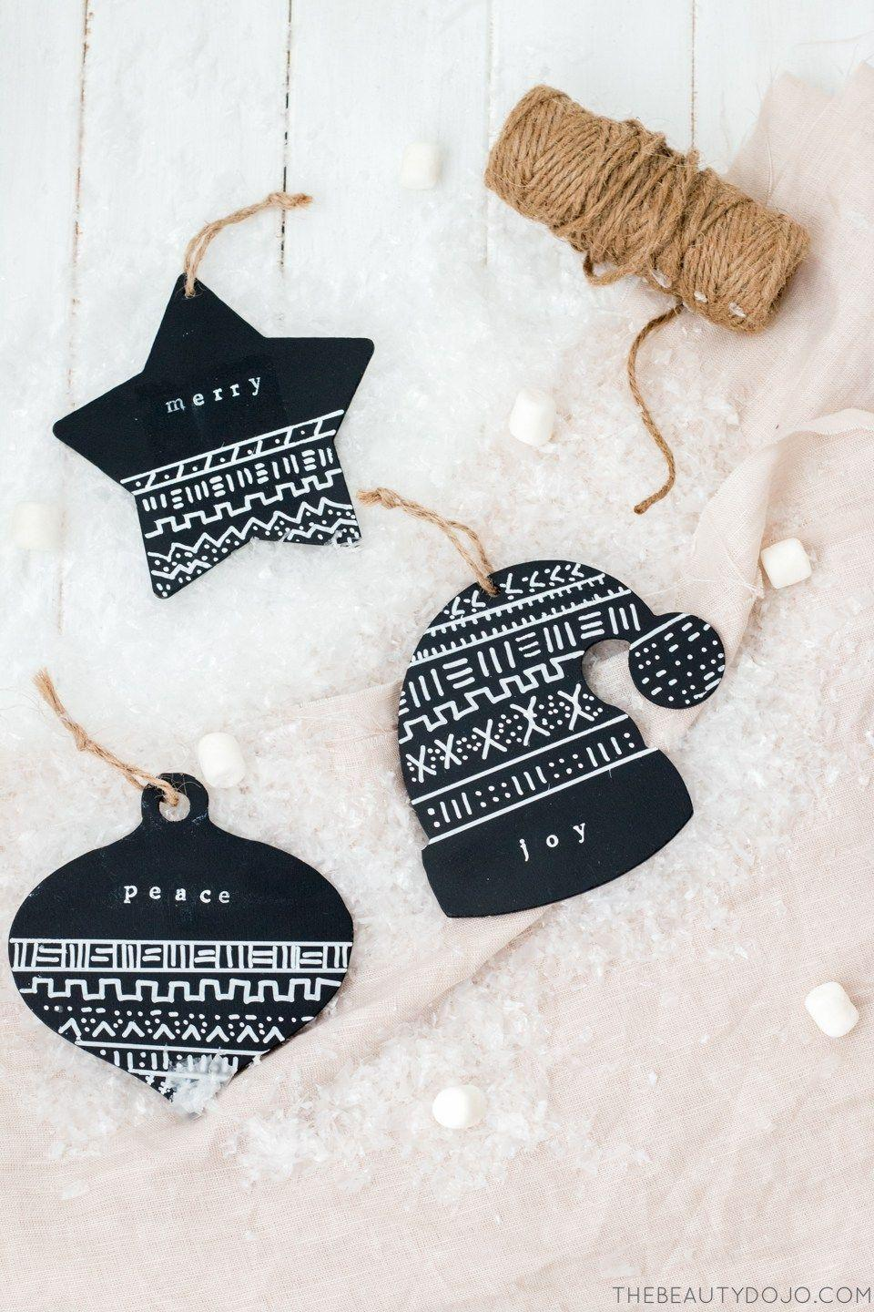 """<p>Black ornaments get a quick, easy update with a bit of white paint and some alphabet stamps. You can write just about whatever you want on these beauties!</p><p><strong>Get the tutorial at <a href=""""http://www.thebeautydojo.com/mud-cloth-ornaments/"""" rel=""""nofollow noopener"""" target=""""_blank"""" data-ylk=""""slk:The Beauty Dojo"""" class=""""link rapid-noclick-resp"""">The Beauty Dojo</a>.</strong></p><p><a class=""""link rapid-noclick-resp"""" href=""""https://www.amazon.com/Molotow-ONE4ALL-Acrylic-Marker-127-102/dp/B0044D5NPQ?tag=syn-yahoo-20&ascsubtag=%5Bartid%7C10050.g.1070%5Bsrc%7Cyahoo-us"""" rel=""""nofollow noopener"""" target=""""_blank"""" data-ylk=""""slk:SHOP WHITE PAINT PENS""""><strong>SHOP WHITE PAINT PENS</strong> </a></p>"""