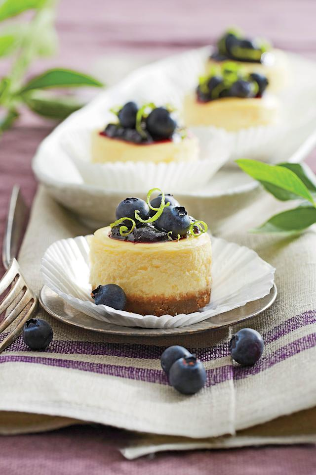 "<p><strong>Recipe: <a href=""https://www.southernliving.com/syndication/petite-blueberry-cheesecakes"">Petite Blueberry Cheesecakes</a></strong></p> <p>As pretty as petits fours, these luscious little two-bite gems can be finished with any kind of berry or preserves. Get ahead, and bake the cheesecakes in advance. After baking, they'll freeze up to one month. Thaw and top with preserves and fruit before serving.</p>"