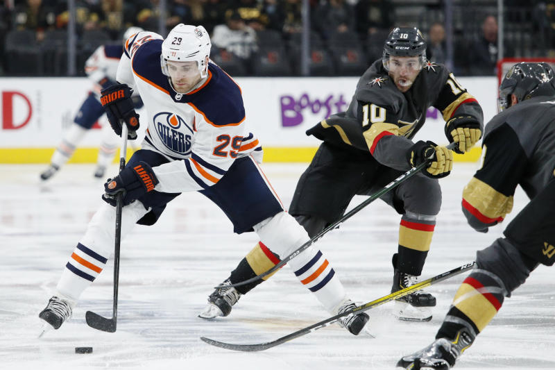 Edmonton Oilers center Leon Draisaitl (29) skates against the Vegas Golden Knights during the third period of an NHL hockey game Wednesday, Feb. 26, 2020, in Las Vegas. (AP Photo/John Locher)