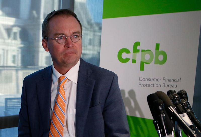 Office of Management and Budget (OMB) Director Mick Mulvaney arrives to speak to the media at the U.S. Consumer Financial Protection Bureau (CFPB), where he began work earlier in the day after being named acting director by U.S. President Donald Trump in Washington November 27, 2017. REUTERS/Joshua Roberts