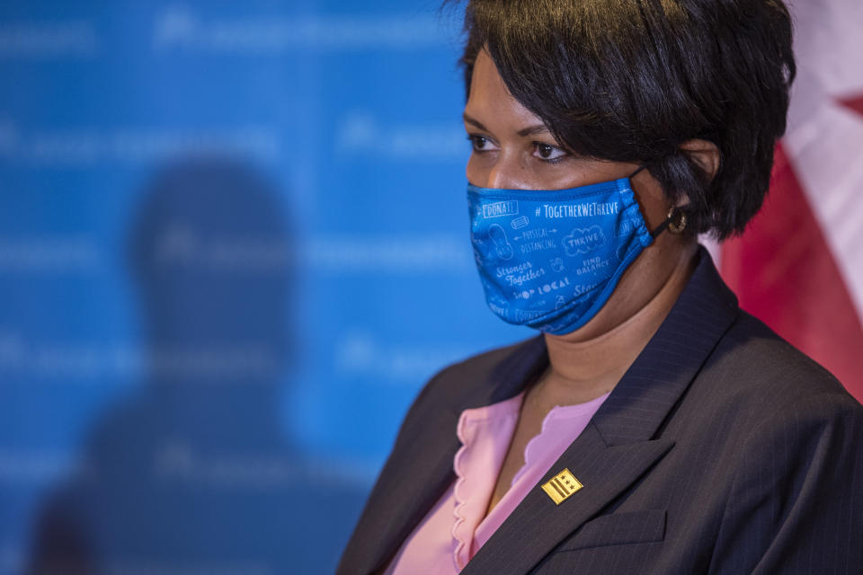 District of Columbia Mayor Muriel Bowser looks on during a news conference following an event to administer the Pfizer-BioNTech vaccine for COVID-19 to frontline workers during a vaccine event at Kaiser Permanente Capitol Hill Medical Center in Washington, Thursday, Dec. 17, 2020. (Shawn Thew/Pool via AP)