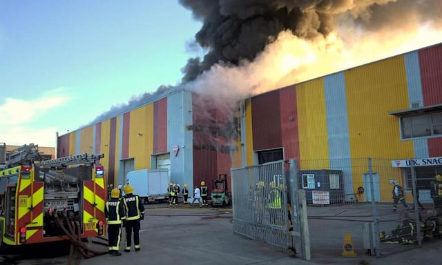 """<span class=""""element-image__caption"""">Plumes of black smoke from the factory could be seen from miles around. </span> <span class=""""element-image__credit"""">Photograph: London fire brigade/Twitter/PA</span>"""