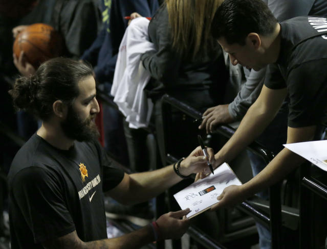Phoenix Suns' Ricky Rubio signs an autograph for a fan prior a regular-season NBA basketball game against the San Antonio Spurs in Mexico City, Saturday, Dec. 14, 2019. (AP Photo/Rebecca Blackwell)