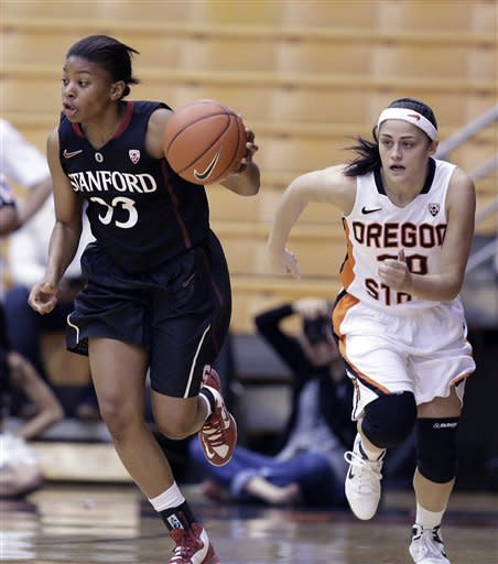 Stanford guard Amber Orrange, left, races downcourt after stealing the ball from Oregon State guard Mollee Schwegler during the first half of an NCAA college basketball game in Corvallis, Ore., Sunday, Feb. 3, 2013. (AP Photo/Don Ryan)